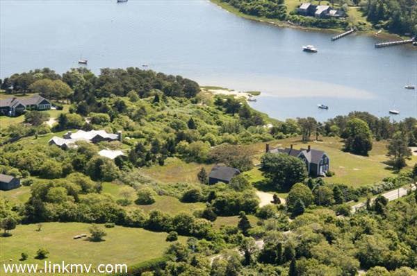 on 3 acres overlooking Quitsa Pond out to the Vineyard Sound.