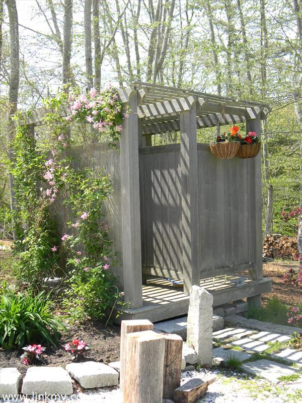 Outdoor shower, detached from house.