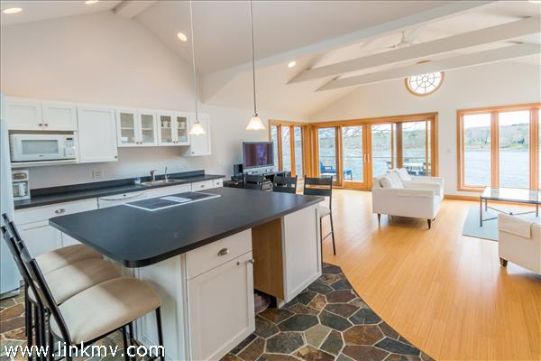 Open floor plan offers kitchen, living and dining area for easy entertaining.