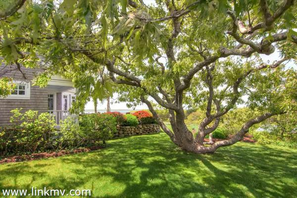 amidst gardens, mature trees and expansive lawn