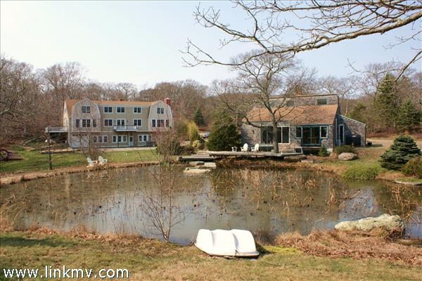 Winter view of main house/guest house/pond