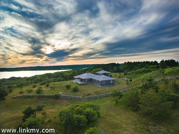 Sunset aerial shot over the property.