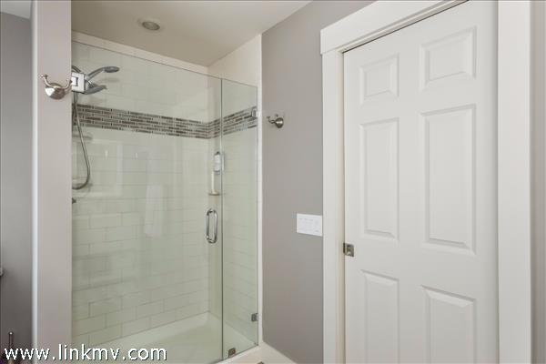 Second floor tiled master bath shower.