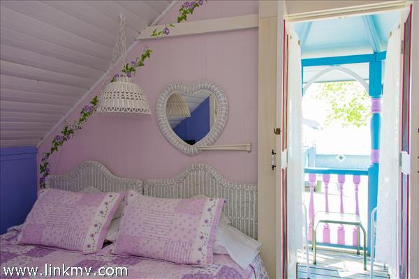 Room 2,  King or (2 Twins) private porch, bath across hall, mini split
