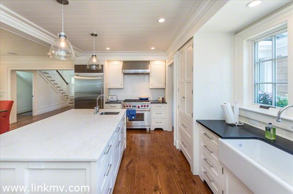 Kitchen Has Commercial Stainless Appliances