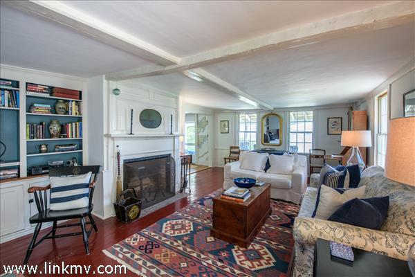 Living room featuring original painting over fireplace