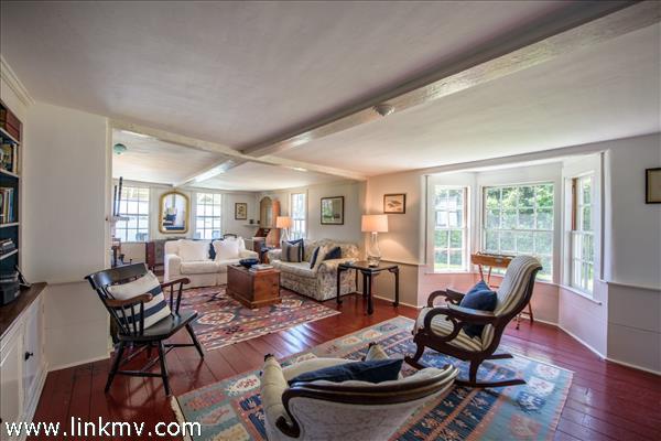 Living room with full bay window overlooking gardens