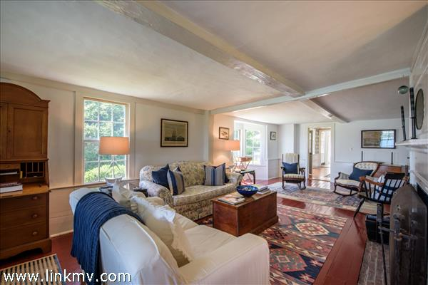 Living room featuring cross beams
