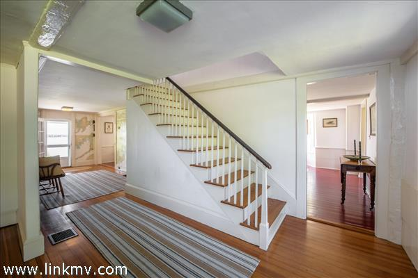 Wide staircase in spacious foyer