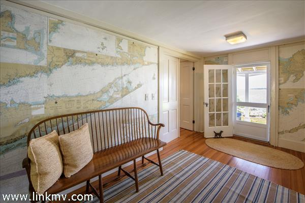 Plaster walls papered with nautical maps of Nantucket and Vineyard Sounds