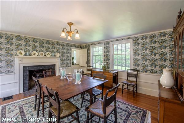 Dining room features wood burning fireplace