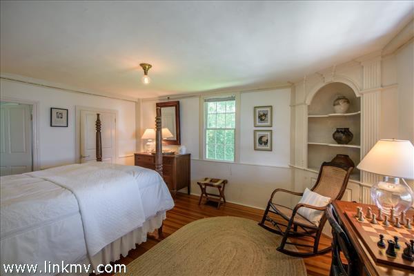 First floor bedroom features gunstock corners and a built-in corner cupboard.