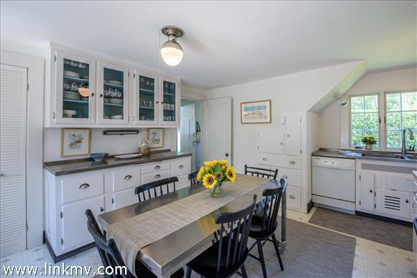 Kitchen features vintage glass fronted  cabinets.
