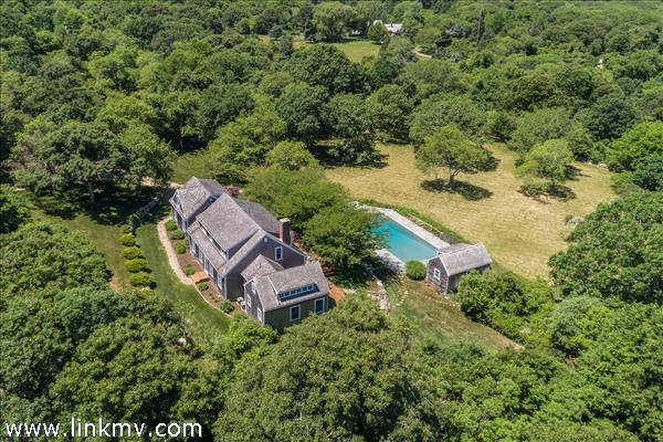 Aerial showing house and pool