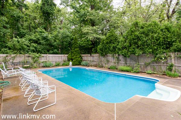 Sunny Pool Area Is Privately Set In Backyard