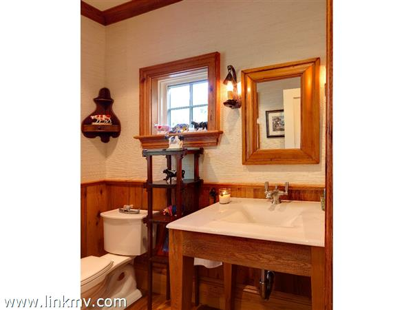 First floor guest powder room with 200 year old oak wood  floors and wainscott.