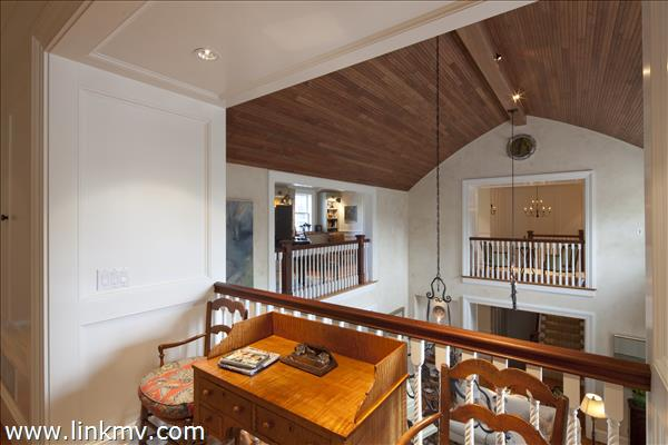 Upstairs view looking at Living Room Mahogany inverted hull ceiling