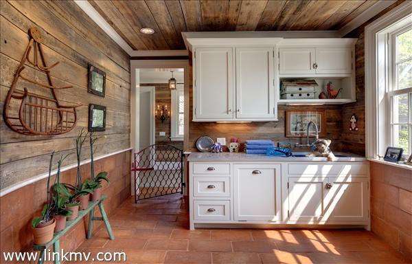 Dog room or flower potting room with radiant heat, blue kohler sink, concrete counter top