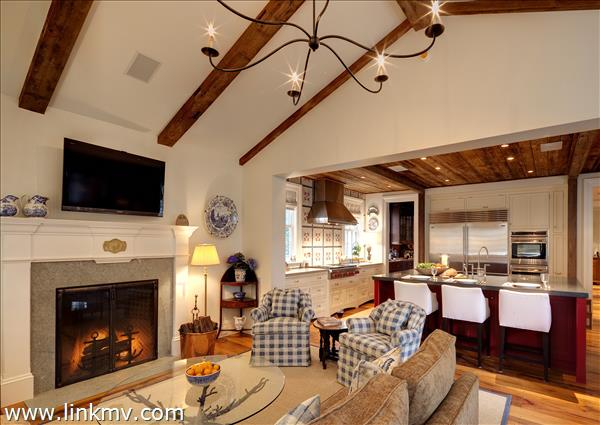 Family Room with fireplace, antiques beams and cathedral ceiling.