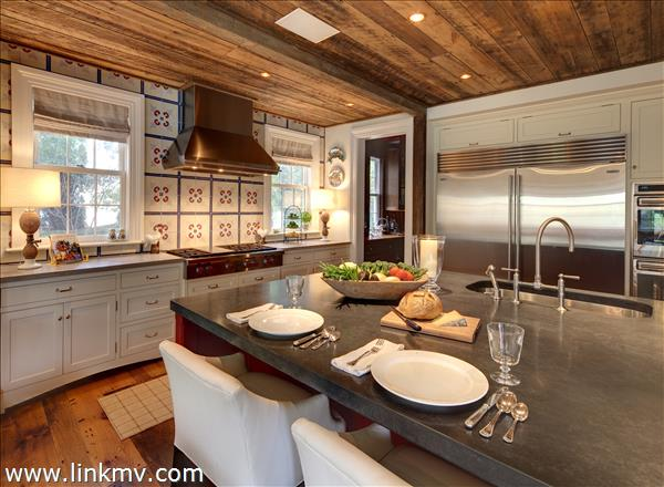 Kitchen with 6x9 concrete island. 200 year old wood ceiling. Concrete countertops.