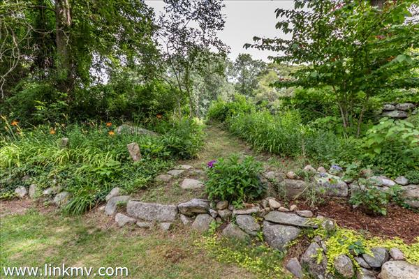 Guest house garden path to field