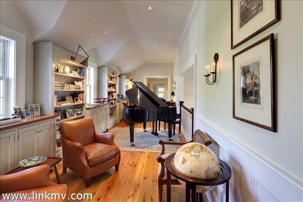 2nd floor library that is open to overlooking living room